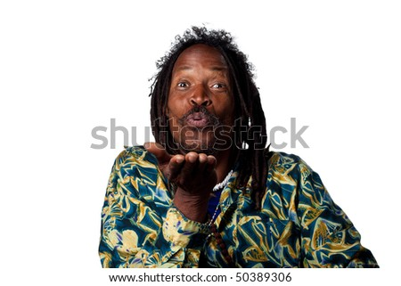 Man blowing a kiss to the camera, isolated image - stock photo