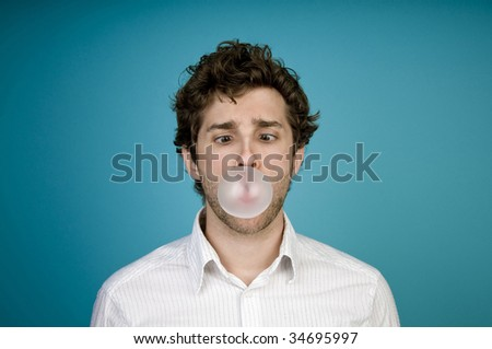 Man blowing bubble with gum