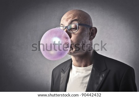 Man blowing bubbles with a chewing gum