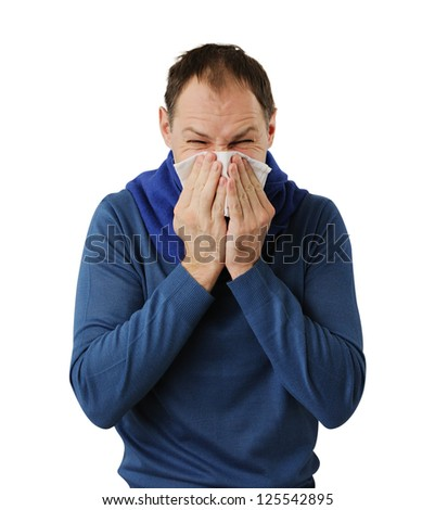 Man blowing his nose isolated on white background - stock photo