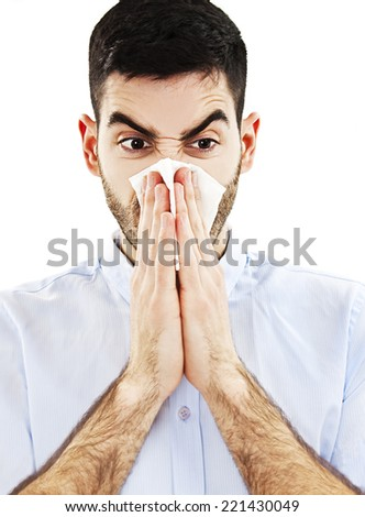 Man Blowing His Nose. Isolated on white background  - stock photo