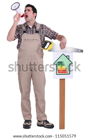 Man blowing into a megaphone and holding a saw over an energy efficiency rating chart - stock photo