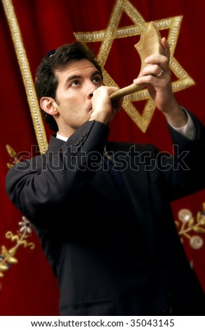 man blowing shofar - stock photo