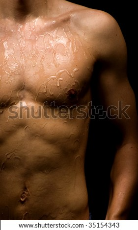 Man body wrapped on a black background - stock photo