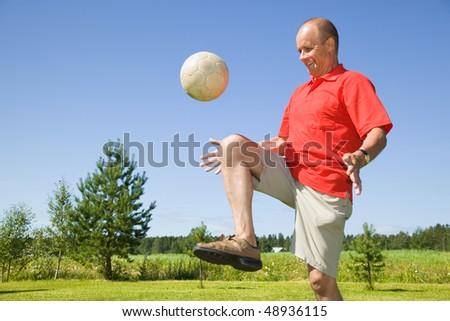 Man bouncing football - stock photo