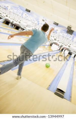 Man bowling, rear view - stock photo