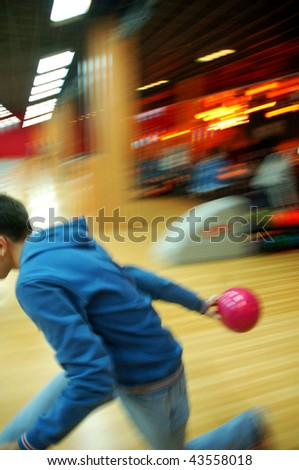 Man bowling, rear view. Selected focus on ball