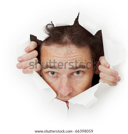 Man breaks out of hole in paper - stock photo