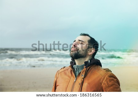 Man breathing free on the beach - stock photo