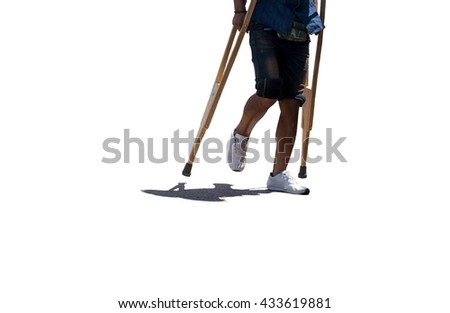 Man broken leg with stitching walking with crutches isolated in contrast and shadow - stock photo