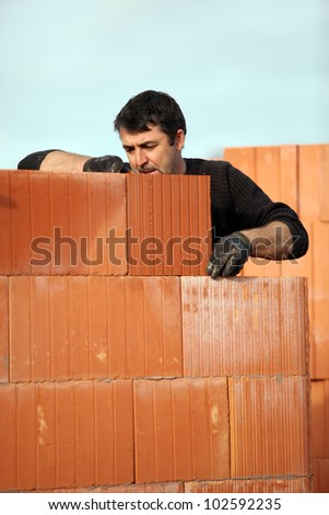 Man building a house - stock photo