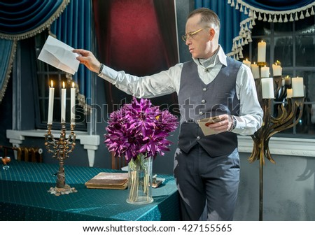 Man burns a letter in candle flame