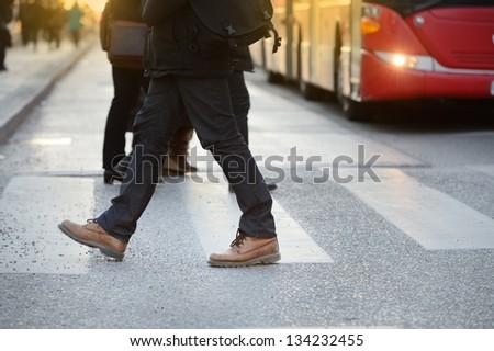 Man, bus and zebra crossing - stock photo