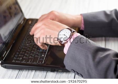 Man business modern in wristwatch. Laptop - stock photo