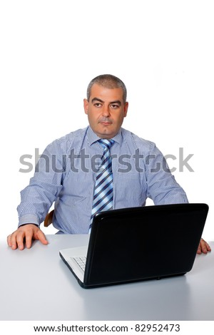 Man businessman blue shirt tie work is concentrated at the table laptop isolated on a white background