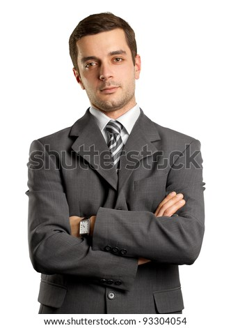 man businessman in suit, looking on camera, with folded hands - stock photo
