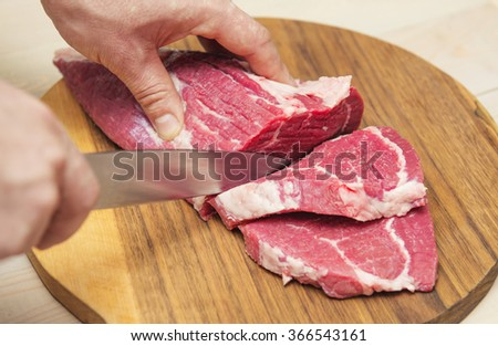 chefs hands knife cuts meat on stock photo 607202270 shutterstock. Black Bedroom Furniture Sets. Home Design Ideas