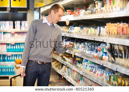 Man buying goods in the supermarket - stock photo