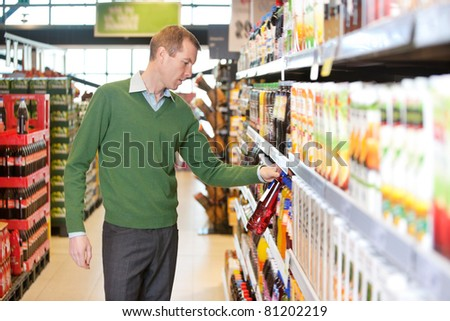Man buying juice in the supermarket