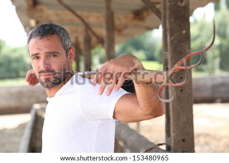 Man by a barn - stock photo