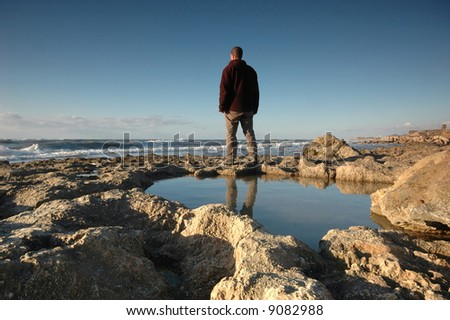 Man by the beach - stock photo