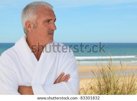 Man by the sea - stock photo