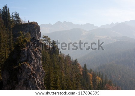 Man by the top of a mountain
