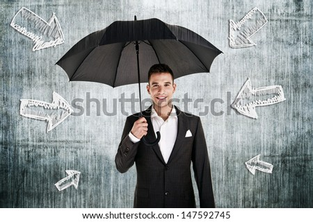 man by the wall with umbrella in his hand