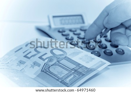 Man calculate - blue toned image - stock photo