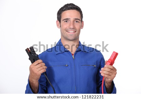 man car mechanic with alligator clips - stock photo