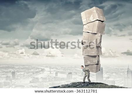Man carry carton boxes - stock photo