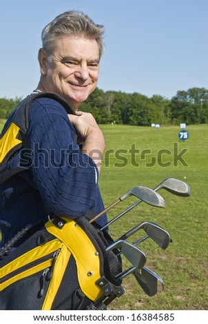 Man Carrying a Golf Bag (Caddy) - stock photo