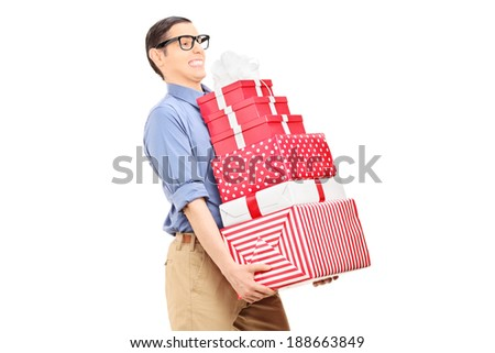 Man carrying a heavy load of gifts isolated on white background