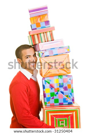 Man carrying a stack of presents - stock photo