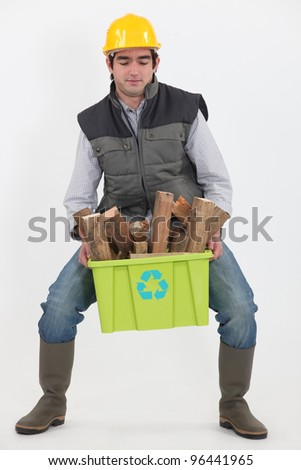 Man carrying box of recyclable wood - stock photo