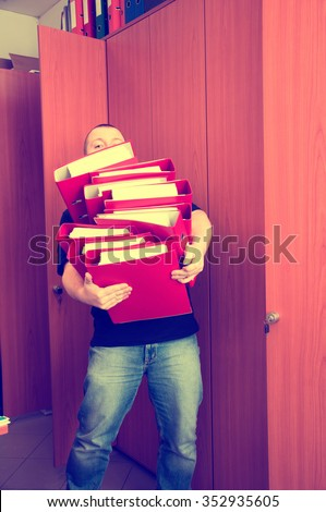 Man carrying folders with documents - too many documents at once