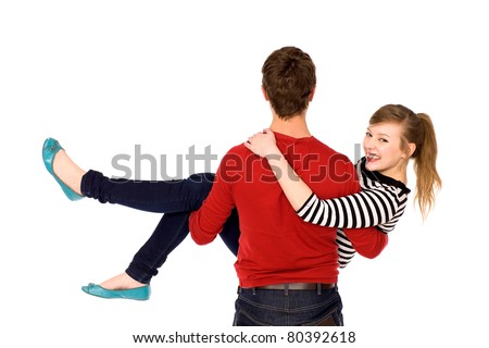 Man carrying his girlfriend in his arms - stock photo