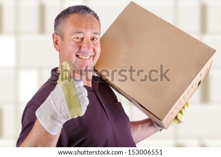 Man carrying moving box - stock photo
