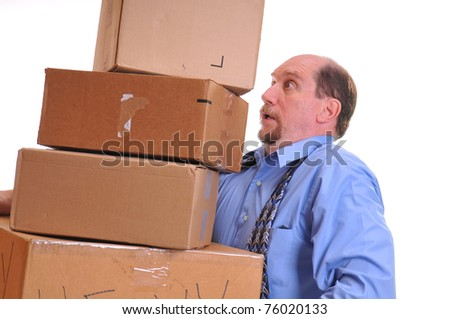 Man carrying several heavy boxes, straining to keep them lifted and balanced. Shot on a white background. - stock photo