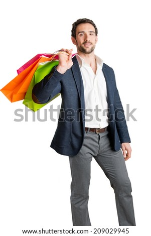 Man Carrying Shopping Bags isolated in a white background - stock photo
