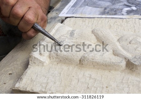 Man carving stone - stock photo