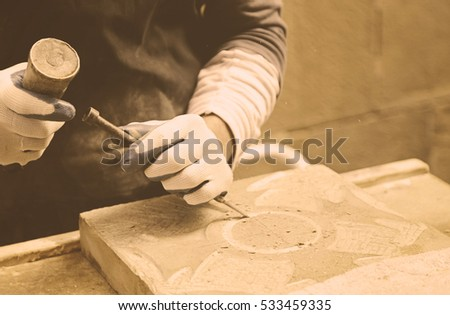 Man carving stone detail of a traditional craftsman working stone worker, crafts