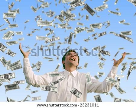 man catching falling dollars - stock photo