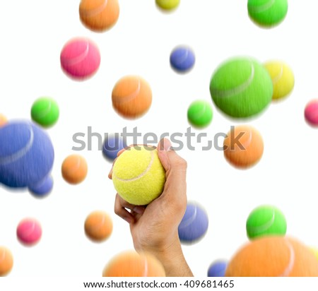 man catching the ball right in a shower of tennis balls - stock photo