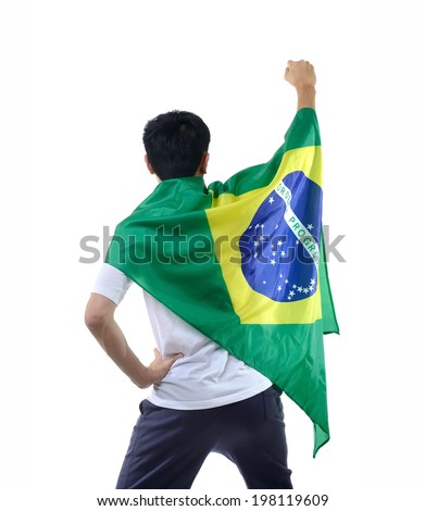 man celebrates with Brazilian flag