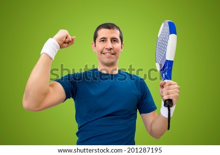 man celebrating victory on the paddle with green background - stock photo