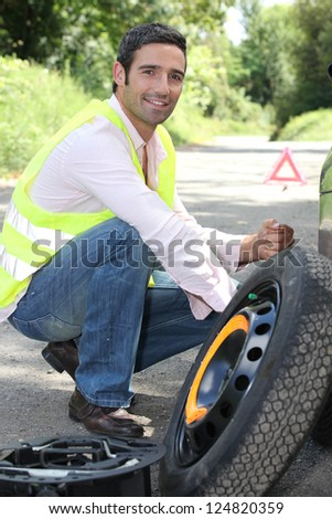 man changing a wheel