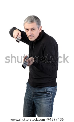 man changing channel with a remote control on white background