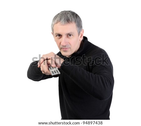 man changing channel with a remote control on white background - stock photo