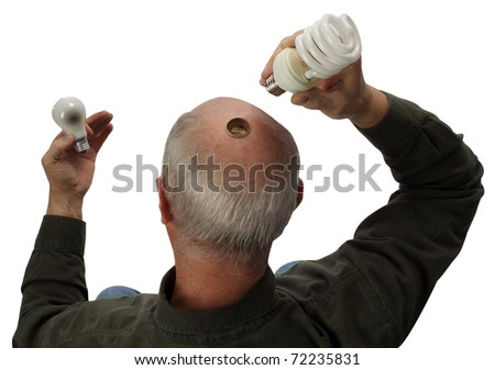 Man changing light bulbs - stock photo